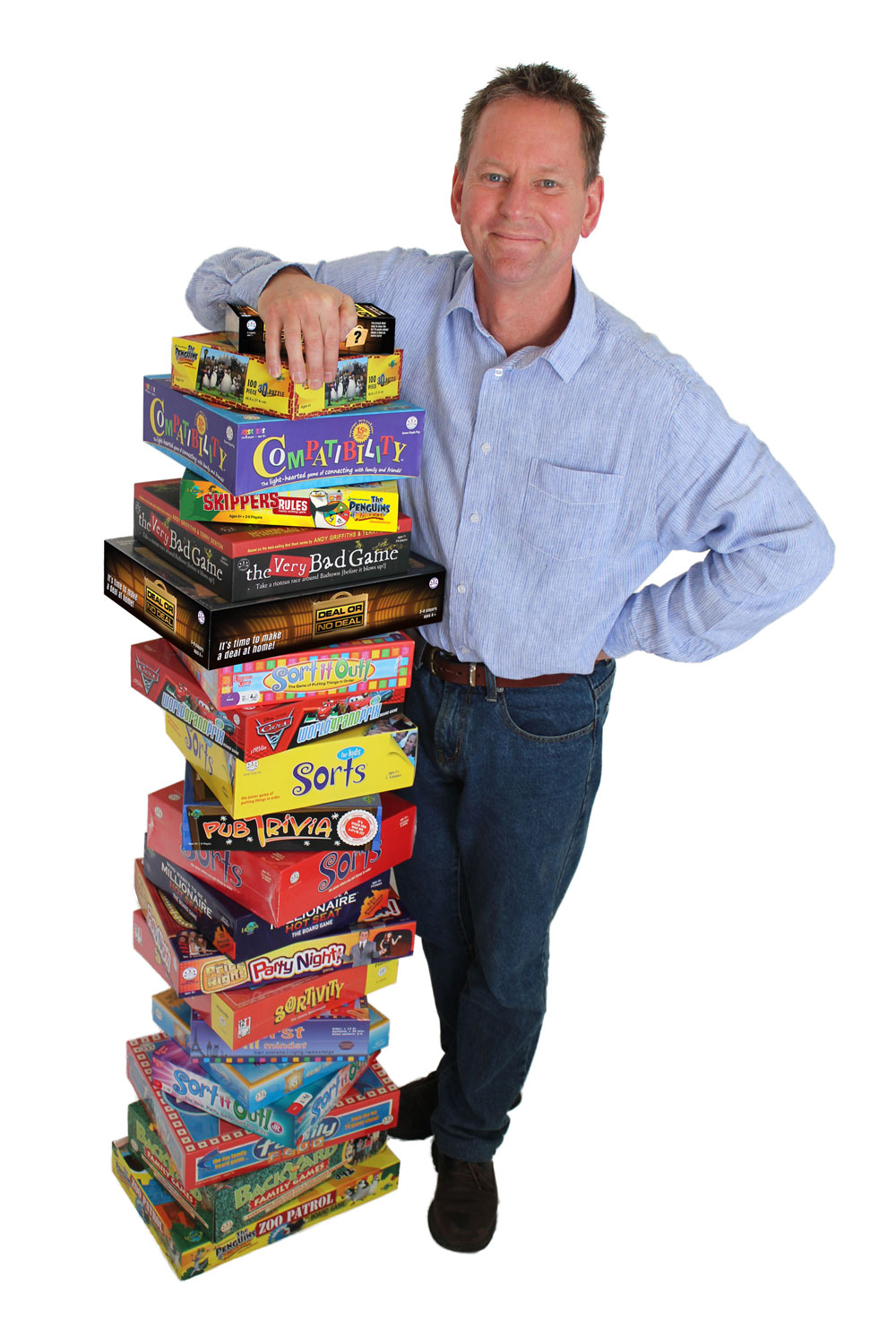 Craig Browne with pile of games he has created.